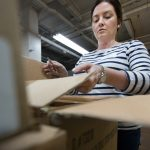 ILEA Cleveland member organizing boxes at charity event