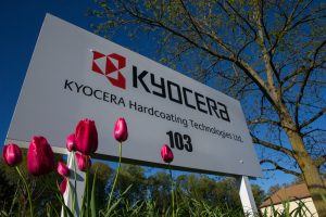 Kyocera sign with flowers