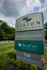 business sign in front of Davis Eye Center